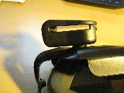 Belt clip attached showing space between clip and cradle